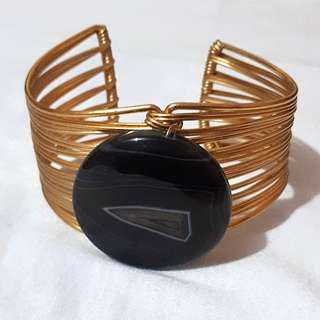 Golden bangle with back pendant