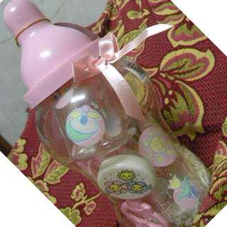 Pink Apple Bank with baby feeding/nursing stuff inside