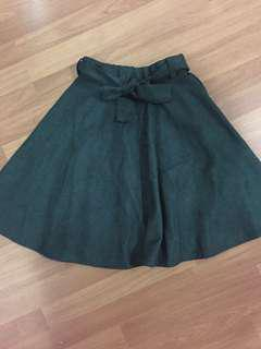 Skirt green suede material