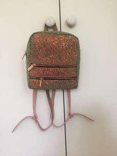 Skinnydip London pink and silver glitter faux leather mini backpack