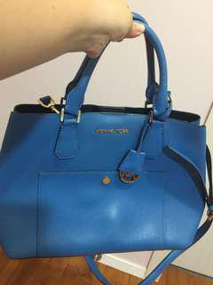 Used blue authentic Michael Kors handbag with sling