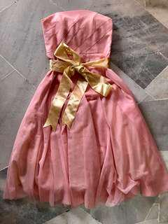 custom made pink dress with yellow ribbon