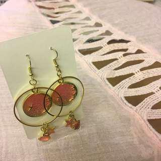 #069 Golden pendant earrings with pink sky, planet and star