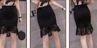 Black asymmetrical lace skirt