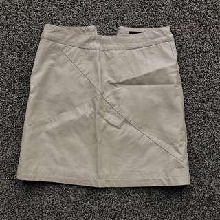 Beige fake leather mini skirt