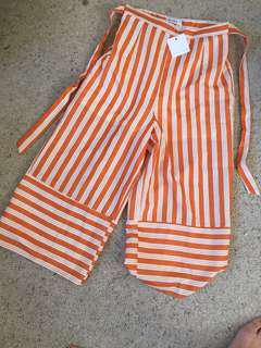 Orange and white striped cullotte wide leg pants