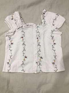 White top with floral design