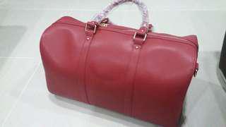 Designer's full leather travel handbag