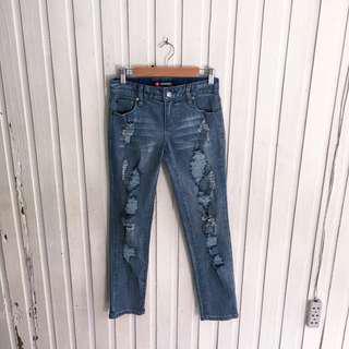 Scissor skinny ripped jeans