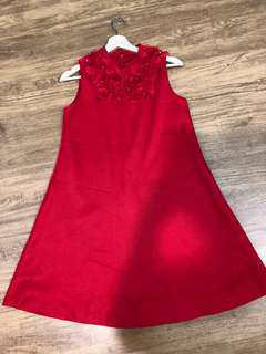 Red sleeveless doll dress