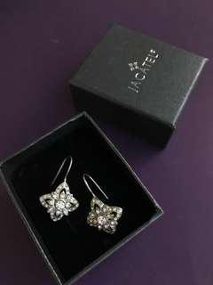 Carolee Silver earrings with Diamond