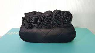 Black evening bag with roses trimming