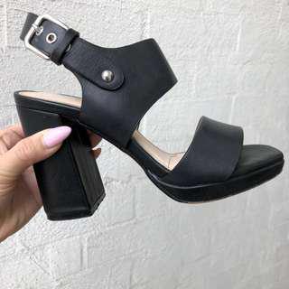 Black leather heels by Siren