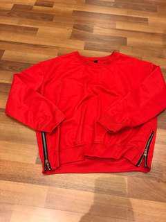 Bright red sweatshirt