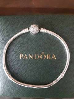 cb584bbb2 Authentic Pandora silver bracelet with crystal heart clasp. Size 20. Barely  used.