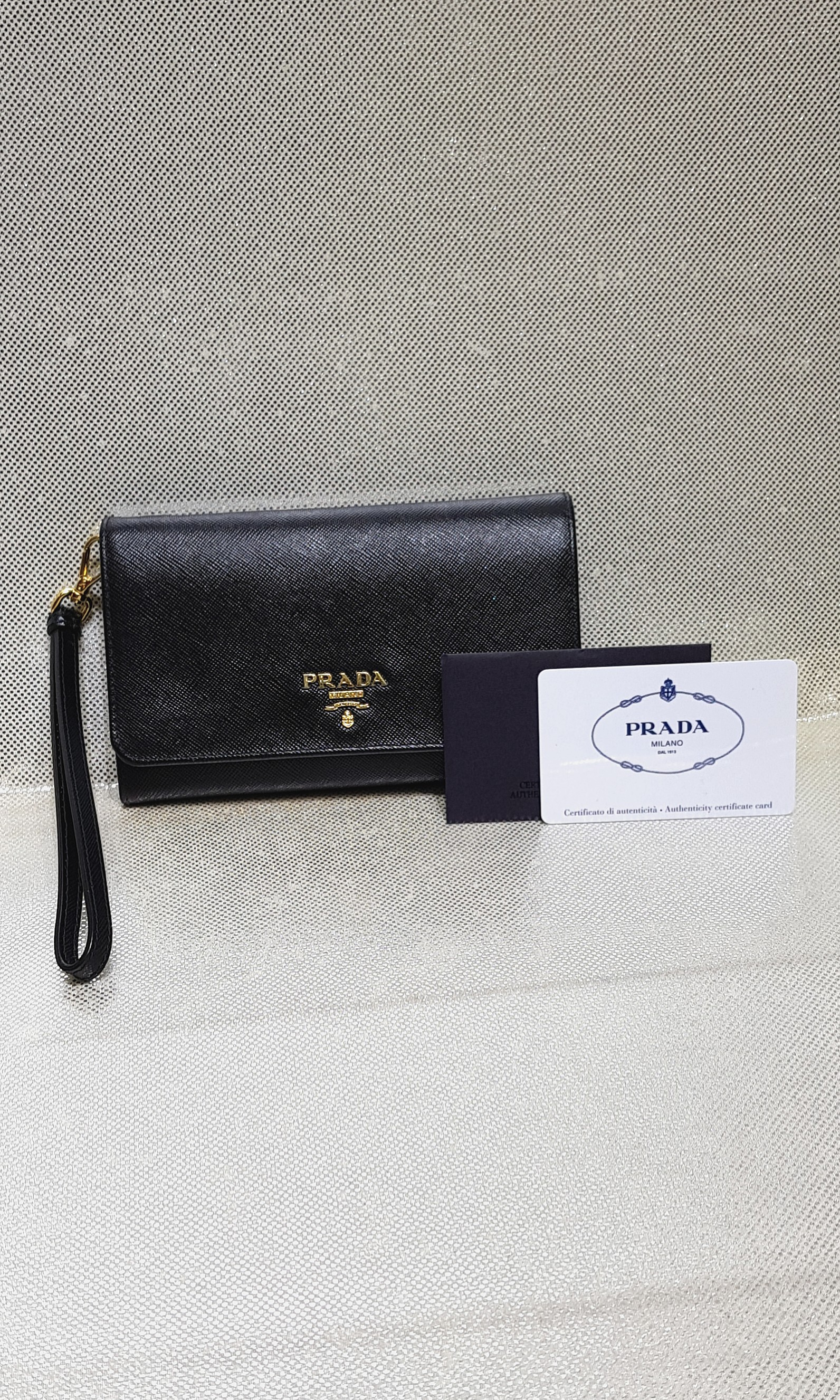 4fdc9d1d9d2a Authentic Prada Black Saffiano Wristlet Wallet, Luxury, Bags & Wallets,  Wallets on Carousell
