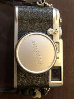 Fujifilm X100 camera with case