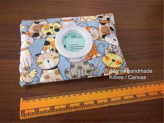 Travel tissue pouch with grommet.  Design: Kitties