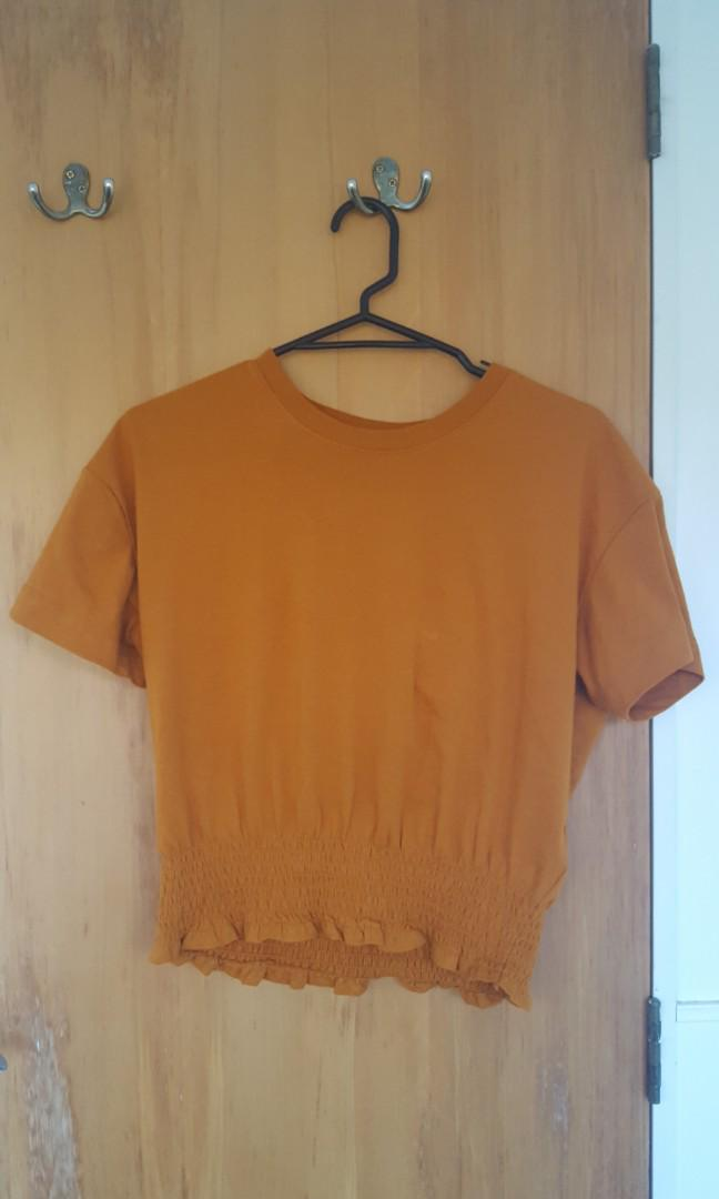 Cute mustard/ orange T-shirt