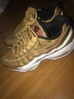 Women's Nike gold sneakers
