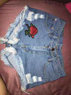 Denim shorts with rose