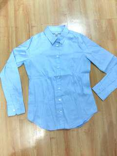 Uniqlo baby blue shirt
