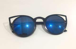 Cat eye sunglasses with blue mirrored lenses