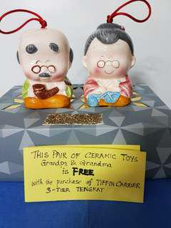 PAIR OF CERAMIC TOYS, GRANDPA & GRANDMA is given FREE WITH THE PURCHASE OF TIFFIN CARRIER.