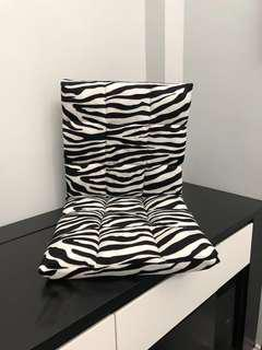Bendable cushion chair with Zebra strip print on the floor