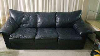 Dark navy black leather pullout couch
