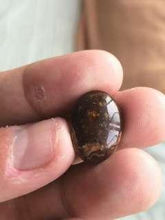 Polished oval cabochon fire agate