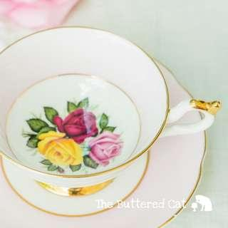 Pretty vintage tri-colour rose cabinet cup and saucer