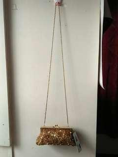 Gold sling party pouch