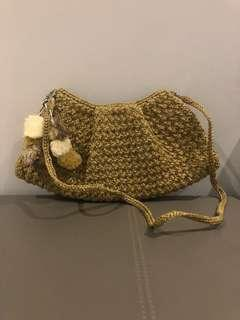 Green crossbody straw bag