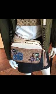 Coach camera bag in signature canvas with patches and rivets