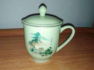 Green mug with lid