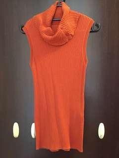 Voyage de Rita burnt orange knitted sleeveless turtle neck top