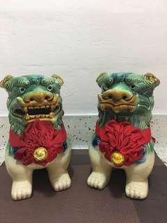 A Pair of Auspicious Jade Green Porcelain Chinese Guardian Lions
