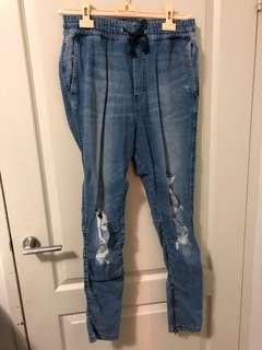 Ripped Blue Jeans with Zippers