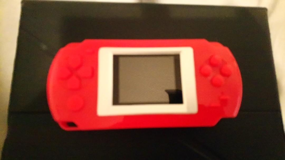 NEW RED HANDHELD GAME SYSTEM. 268 BUILT IN GAMES $45