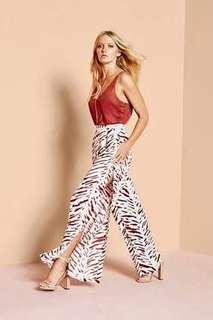 Sheike high waisted split leg animal print pants Sz 10