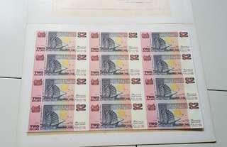 紫色$2 12張連体钞'有封套.
