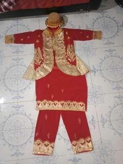 Baju adat laki laki minangkabau
