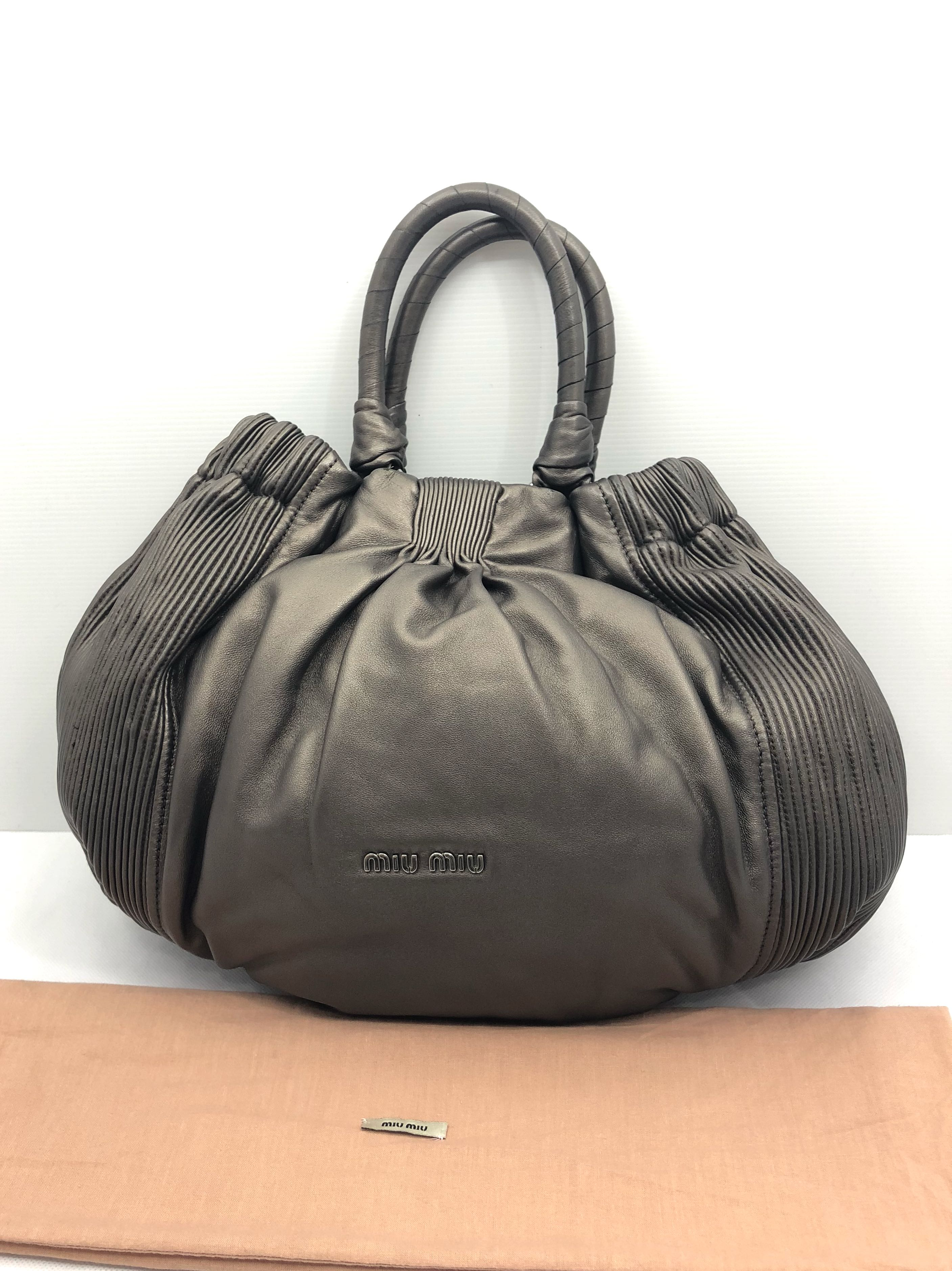 0706db1c2a54 miumiu leather hang bag 187002292