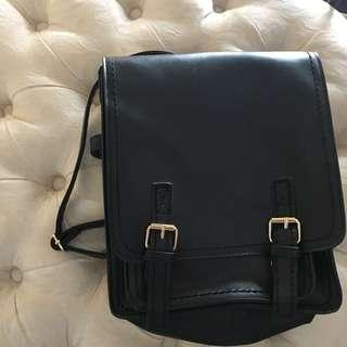 Faux leather black trendy backpack