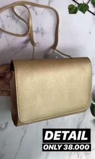 H & M tas sling bag mini gold
