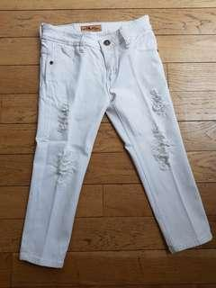 Mid length distressed white jeans