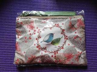 Cloth pouch with pretty bird and plant design