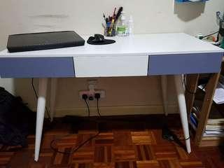 Designer table with two drawers and office chair
