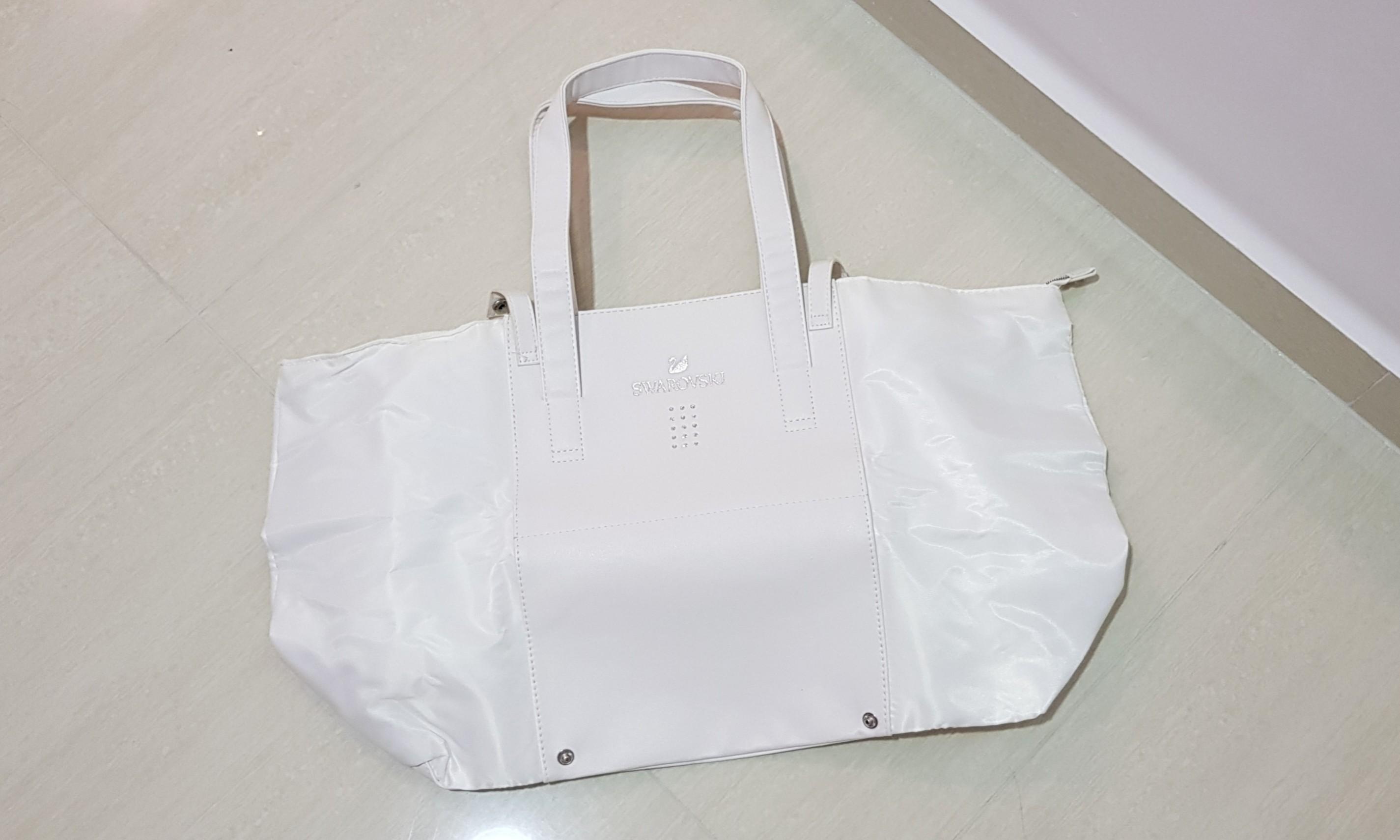 6294b61dd4c Swarovski crystal white tote bag, Women's Fashion, Bags & Wallets, Handbags  on Carousell